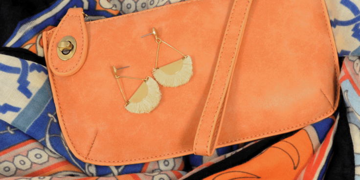 Lux Crossbody Wristlet Clutch in cantaloupe from Live in the Light